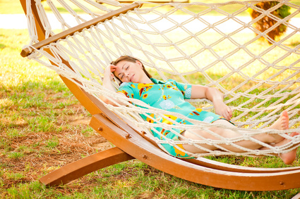 Girl In Dress Resting In A Hammock